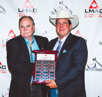 LMAC President Rob Bergevin (right) with 2018 LMAC Hall of Fame inductee Gene Parks.