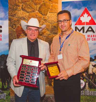 Mike Fleury (left) accepts his Hall of Fame Award from Scott Anderson.